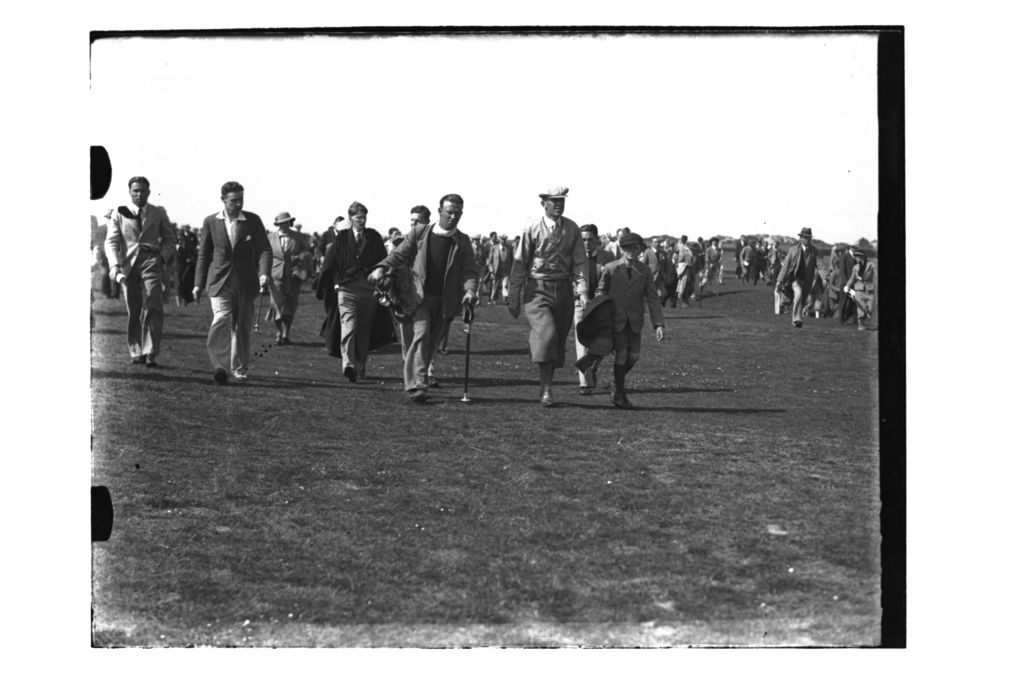 Golfer and crowds walking on the Old Course, St Andrews, The British Amateur Championship, 1936.