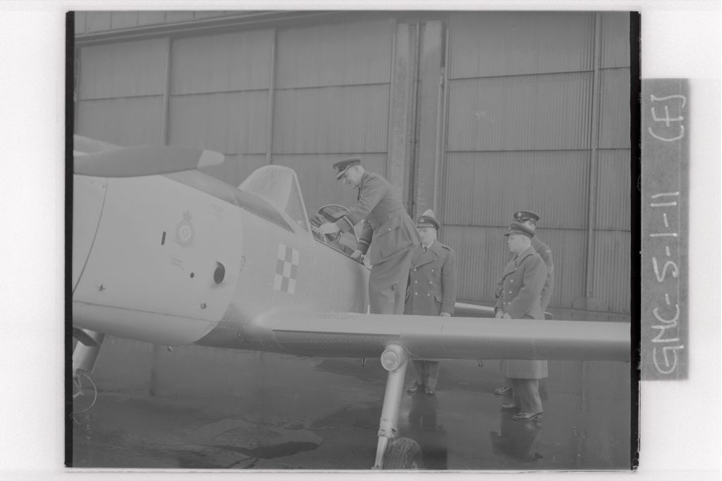 The Air Officer Commanding [J F Hobler] inpects a Chipmunk plane during his visit to University of St Andrews Air Squadron, RAF Leuchars.