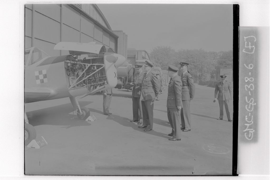 The Air Officer Commanding J F Hobler inpects a plane during his visit to University of St Andrews Air Squadron, RAF Leuchars.