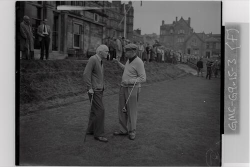 The new captain, Francis Ouimet, chats with a past captain before he plays in on the first Tee, the Old Course, St Andrews