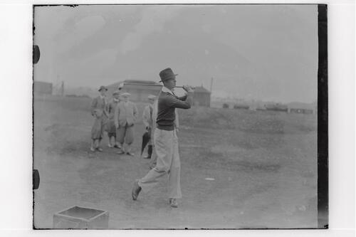 The Walker Cup Match 1934. Johnny Fischer tees off on the Old Course, St Andrews.