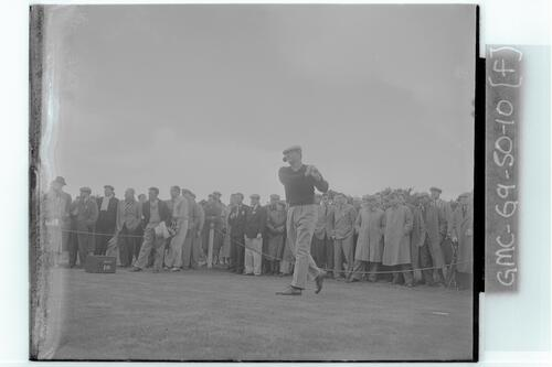 The Walker Cup Match, 1955. A golfer tees off on the Old Course, St Andrews.