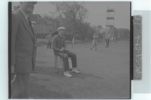 The Walker Cup Match, 1959. A golfer waits to play, Muirfield.