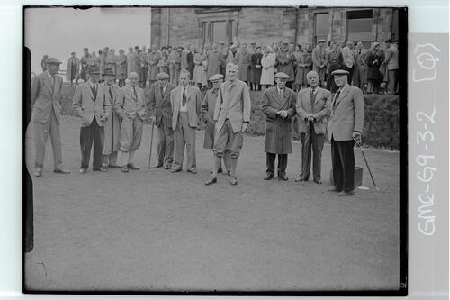 Sir John Simon, the new captain of the Royal and Ancient Golf Club and other past captains, waits for the return of his ball on the first Tee of the Old Course, St Andrews.