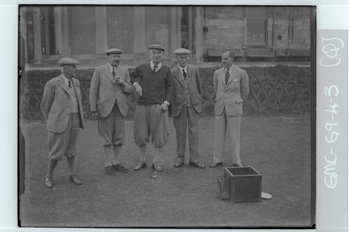 Five golfers on the first Tee of the Old Course, St Andrews.