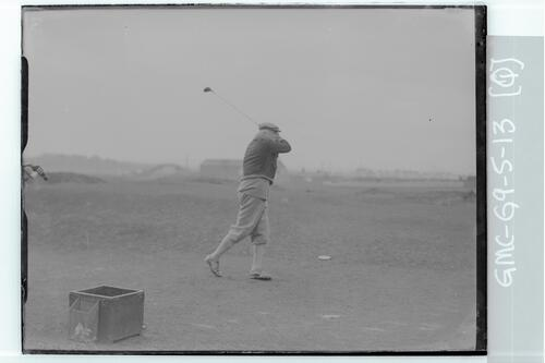 Sir John Simon teeing off on the Old Course, St Andrews.