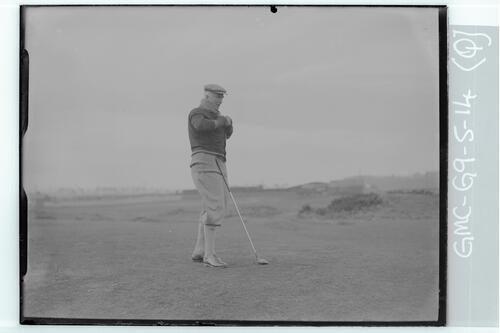 Sir John Simon wrapping up after driving on the Old Course, St Andrews.