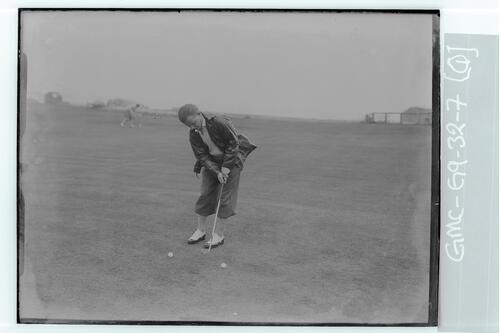 The Walker Cup Match 1934. Johnny Goodman practising his putting, the Old Course, St Andrews.