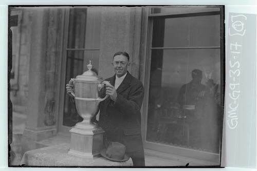 The Walker Cup Match 1934. Francis Ouimet, Captain of the winning American Team with the Walker Cup, the Old Course, St Andrews.