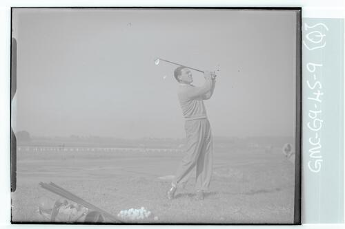 The Walker Cup Match 1947. A golfer practices driving on the Old Course, St Andrews.