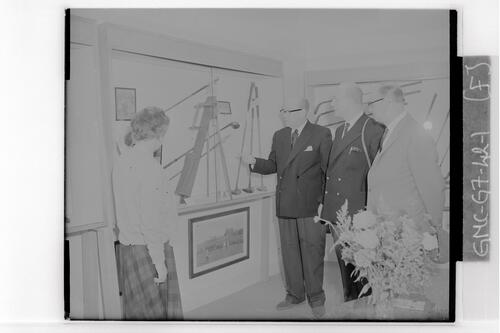 Mr James Millar (centre), Manager of Forgan's conducts visitors round the Forgan Golf Museum during the Centenary Open Championship, St Andrews.