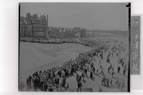 Crowds converge on the 18th green of the Old Course to see the final strokes in the Centenary Open Championship, St Andrews.