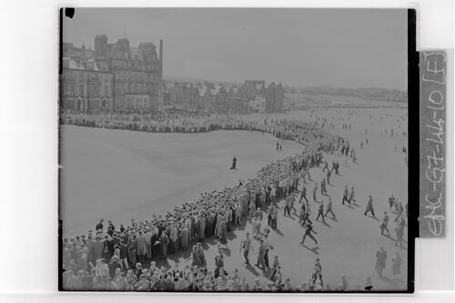 The scene at the 18th green on the Old Course with the gigantic crowd watching Ken Nagle and Roberto De Vicenzo hole out, the Centenary Open Championship, St Andrews.