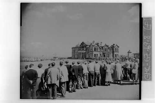 Crowd scene at the 18th hole of the the Old Course and the Royal and Ancient Golf Clubhouse, the Centenary Open Championship, St Andrews.