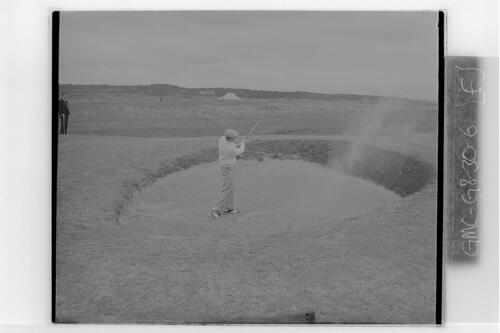 D A Proctor (South Africa) plays out of a bunker at the British Amateur Golf Championship, Troon.