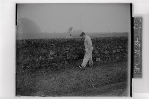 Golfer by a wall on the Old Course, the British Amateur Golf Championships, St Andrews.