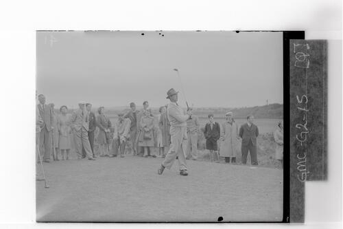 Sam Snead teeing off.