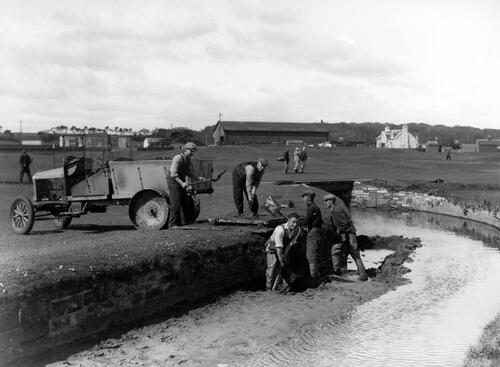 Running repairs to the Swilken Burn, Old Course, St Andrews, during the Walker Cup, 1934.