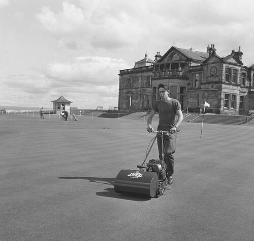 Greenkeeper mowing, St Andrews.