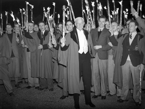 Sir David Munro and students during the evening torchlight procession around St Andrews.