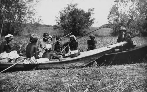 Hunting party sitting in punts, India.