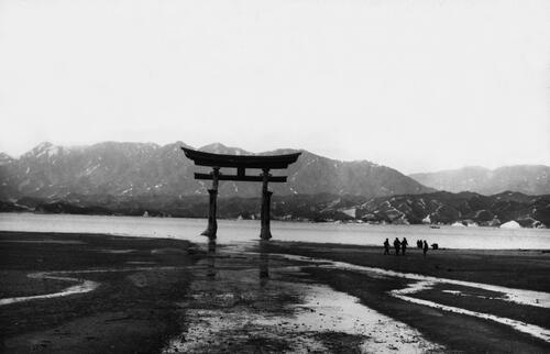 Torii gate set on the shore, Miyajima Island, Japan.