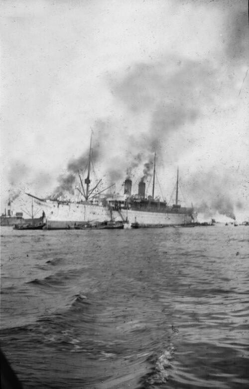Passenger ship making steam in harbour.