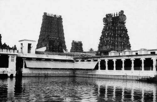 The two Gopura roofs of Minakshi and Sundareshvara Sanctuaries, from the Golden Lily Tank, Meenakshi Amman Temple, Madurai.