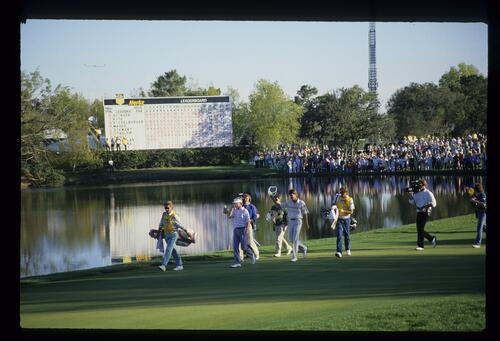 Eventual winner and runner-up, Paul Azinger and Tom Kite are welcomed onto the 18th green at the conclusion of the 1988 Hertz Bay Hill Classic