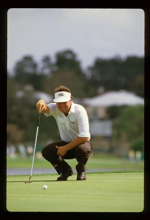 Golfer Lanny Wadkins lining up his putt at the 1986 Hertz Bay Hill Classic Golf Tournament