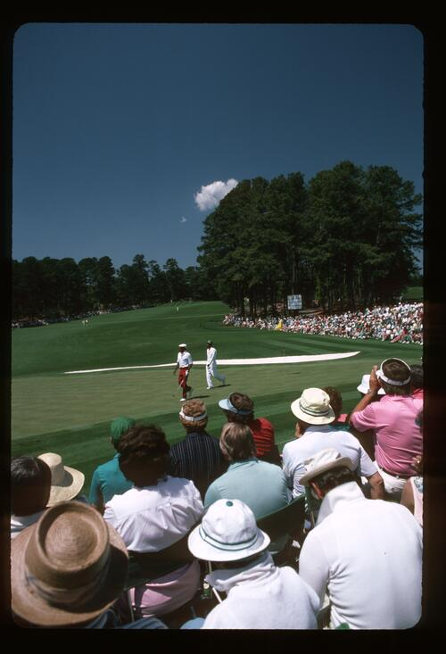 Calvin Peete on the Second Green with his Caddie at the 1986 Masters Golf Tournament