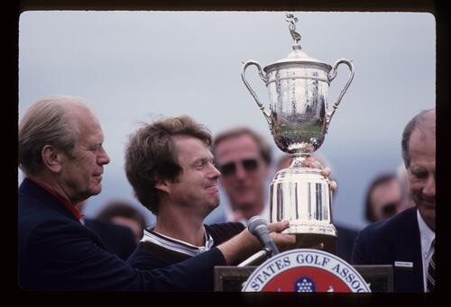 Tom Watson and President Gerald Ford admire the 1982 US Open trophy after Watson's victory