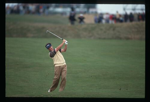 Tom Watson plays his iron from the fairway at The Open Championship