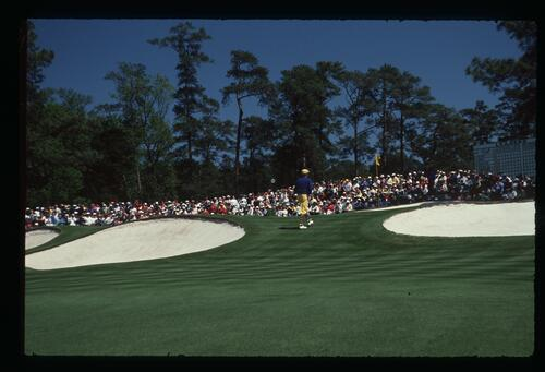 Golfer Payne Stewart walks between to bunkers to the seventh green at Augusta at the 1990 Masters Championship