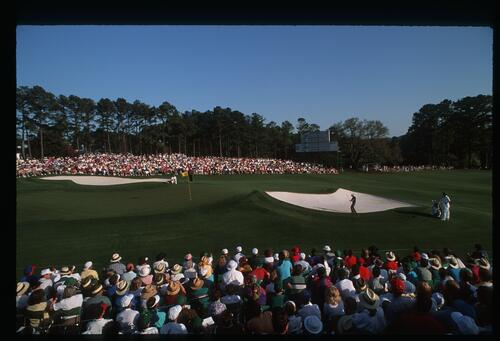 Steve Elkington plays his greenside bunker shot at the 18th hole at the 1993 Masters Championship at Augusta