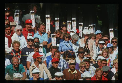 The crowds watch the action through their periscopes at the 1987 US Open Championship