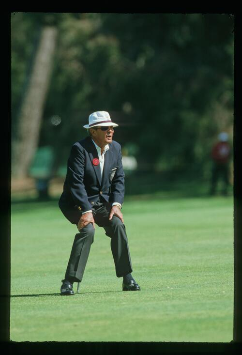 An official of the 1987 US Open Championship watches the action at the Olympic Club