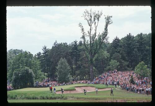 Golfers Jack Nicklaus and Payne Stewart walk onto the 6th green at Oak Hill during the1989 US Open Championship
