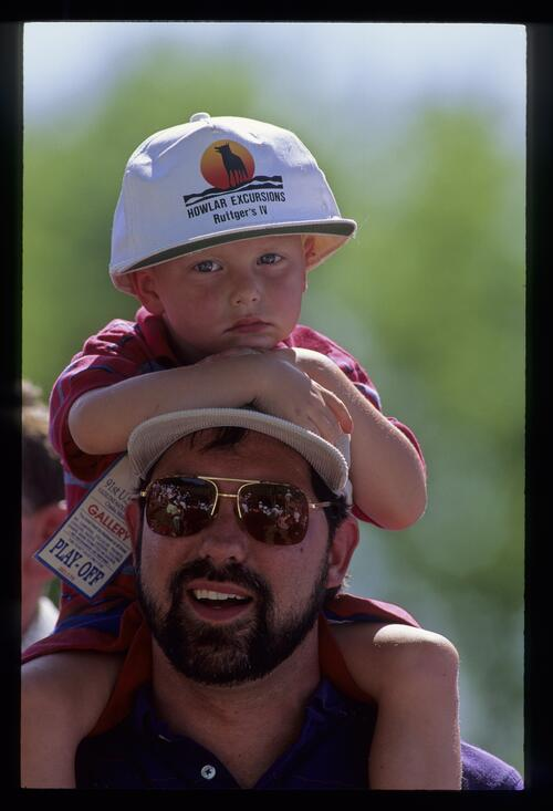 A father and his young son enjoy a day out at the United States Open Championship