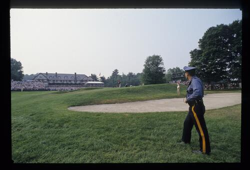 A Police Officer watches the action at the United States Open Championship at Baltusrol