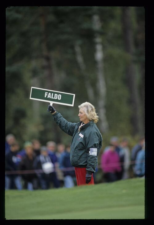 A forecaddie marks Nick Faldo's ball at the World Match Play Championship