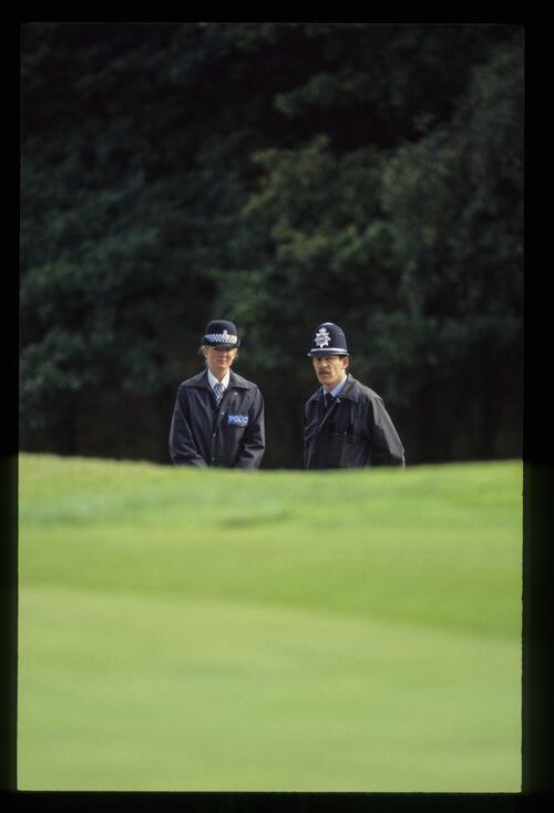 Two police officers watch the action at the World Match Play Championship at Wentworth