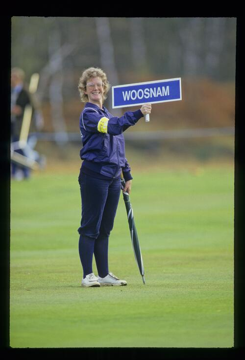 Ian Woosnam's forecaddie smiles for the camera at the World Match Play Championship