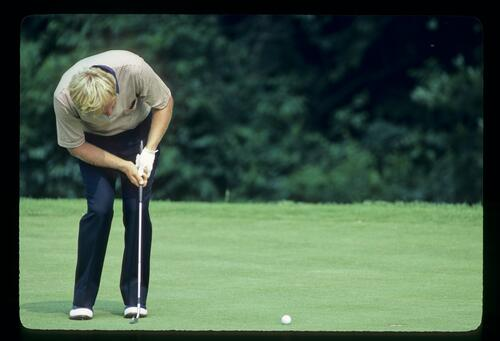 Jack Nicklaus follows the line of his putt into the hole at the 1981 US Open