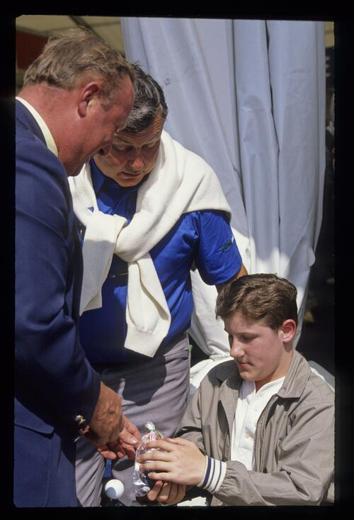 Michael Bonallack and Peter Alliss present a new powered wheelchair at the 1990 Open Championship
