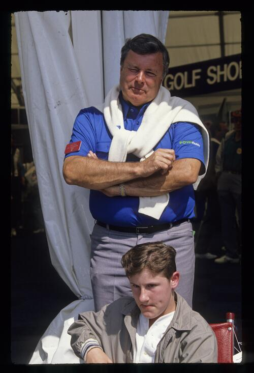 Peter Alliss with one of the young recipients of a powered wheelchair at the 1990 Open Championship