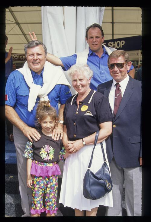 Peter Alliss and Lawrence Levy pose with a family at the 1990 Open Championship