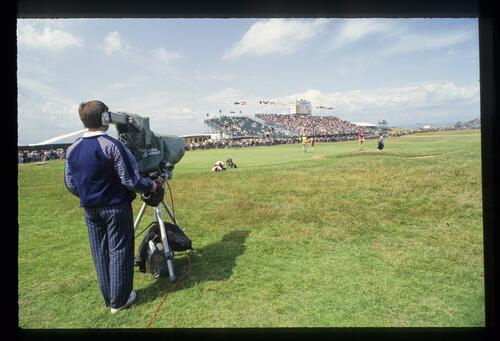 The cameraman catches the action as Payne Stewart makes his putt at the 1992 Open Championship