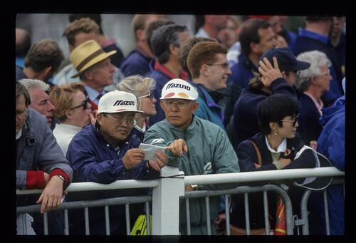 Asian fans checking the drawsheet at The Open Championship
