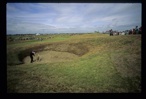 Splashing out of a deep fairway bunker at Royal St Georges during The Open Championship